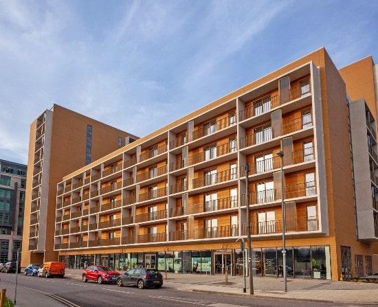 build to rent properties Leeds yellow building